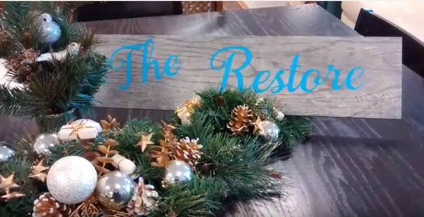 wreath with handmade ReStore sign