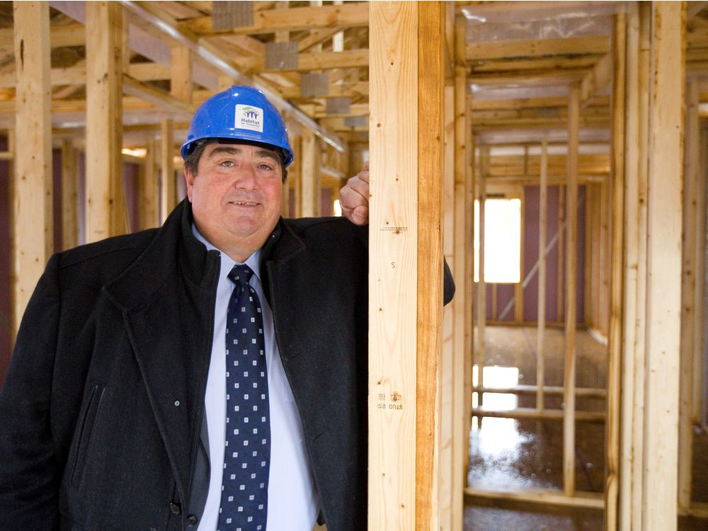 picture of Habitat CEO, Brian Elliot in one of the framed homes on Forbes Street