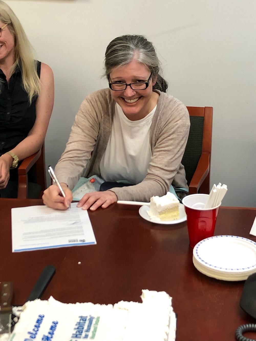 Kari signing partner letter